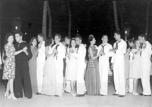 WWII Sailors and Co-EdsSailors and co-eds take a turn around the dance floor during World War II. These Naval Air Corps men were in Miami to take advantage of 15-week courses in aeronautics, ground school, theory, and flight training. Many of the classes were held on the North Campus; others were held at Richmond, Opa Locka, and a Miami Beach Summer College.