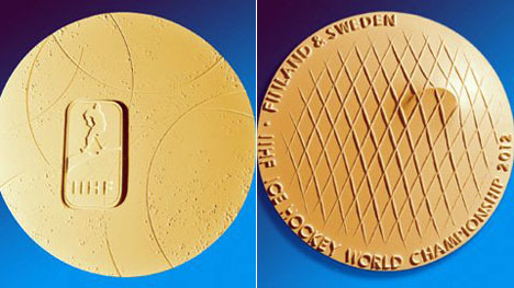 The new gold medal for the IIHF Ice Hockey World Championship. See what that is on the back? That's a puck hitting the goal net. How cool is that? Great design! Artsy Hockey Medal Wins Design Comp - Core77