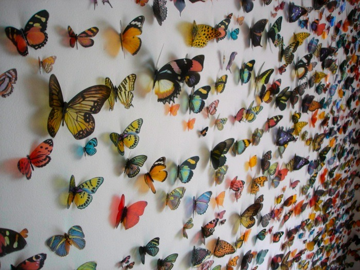 pulmonaire:  Swarm by Kristi Malakoff uses 6,000 color copies of butterflies on transparent material.
