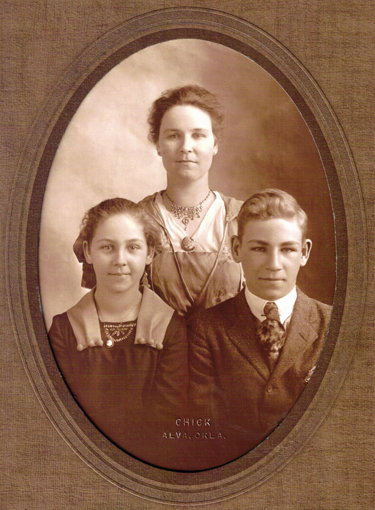 My great-grandmother Carrie Mae with my great-aunt Elsie and my grandfather Floyd. About 1912.