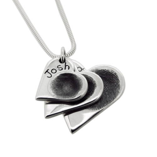 Another triple layered pendant, heart shaped this time. They are beautiful even if i do whinge the whole time i make them (they are sooo difficult to polish). Really lovely clear fingerprints. On a side note, the best of british exhibition is in full swing now and the shop is dressed up to the nines. We have bunting and union jack dinosaurs and a telephone box. If you are in the area come and sneak a peak. Oh and there's some nice jewellery too.