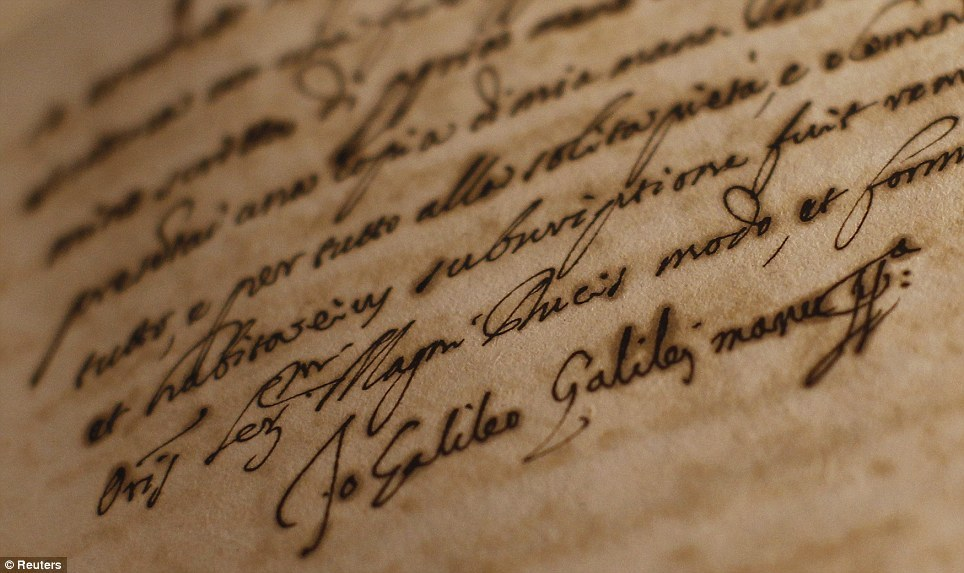 The signature of Galileo Galilei is seen on a document displayed as part of the exhibition. A report on the Italian astronomer's 1633 trial for asserting that Earth revolved around the Sun, is on show