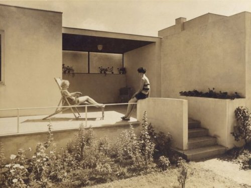 Glamorous lounging at modernist house in pre-war (I hope thats not war-period fascist girls lounging??? Hope not, because fascists seemed to hate modernism.) Wroclaw.