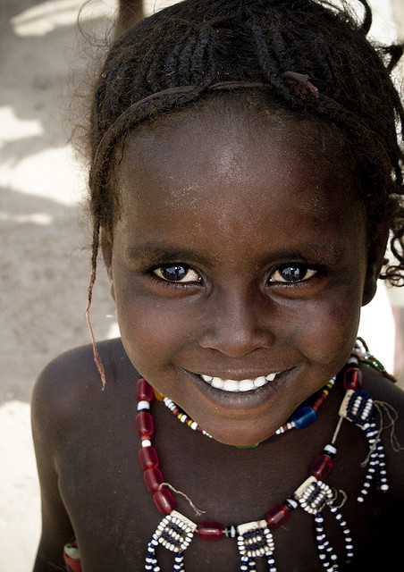 valscrapbook:  Young Afar girl smiling, Ethiopia by Eric Lafforgue on Flickr.