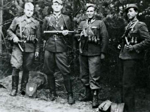 "The 'Cursed soldiers' of the anti-communist underground. Left to right: Henryk Wybranowski ""Tarzan"" (killed Nov. 1948), Edward Taraszkiewicz ""Żelazny"" (killed Oct. 1951), Mieczysław Małecki ""Sokół"" (killed Nov. 1947), and Stanisław Pakuła pseudonym ""Krzewina"". Photo: June 1947."