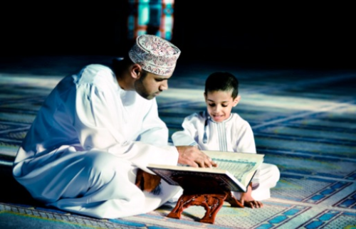 A dad teaching quran