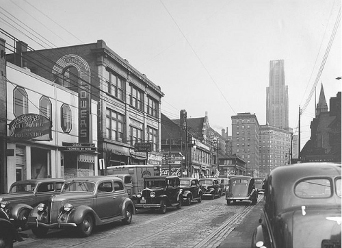 thepittsburghhistoryjournal:  Forbes Avenue near Atwood Street in the Oakland neighborhood of Pittsburgh, with the Cathedral of Learning in the background, 1937 [Flickr]