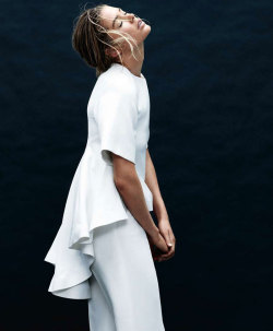 Doutzen Kroes in a white-hot ensemble for Harper's Bazaar, rocking that pretty peplum like a pro! (Image via Fashion Gone Rogue)