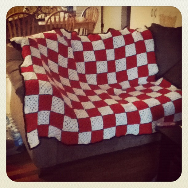 This blanket is huge. AND finally finished (: #granny #square #crochet #yarn #blanket #blanket #personal #white #red (Taken with instagram)
