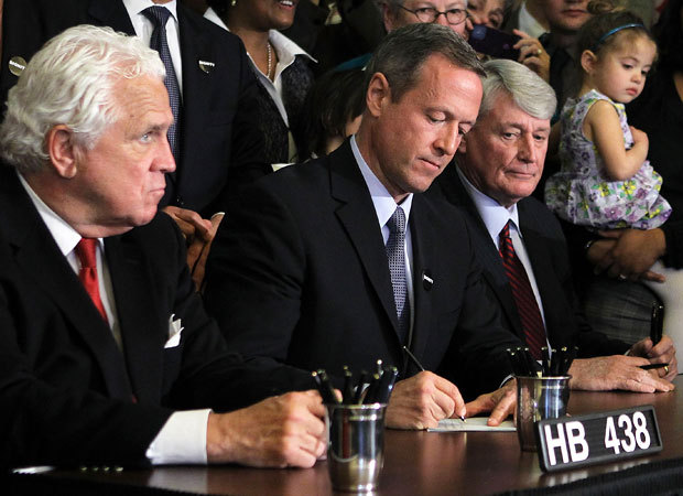 Maryland Gov. Martin O'Malley signs the state's recently passed same-sex marriage bill into law during a ceremony at the Maryland State House on Thursday in Annapolis. The law is expected to face a referendum in the November election before it goes into effect in January 2013. (Alex Wong/Getty Images)