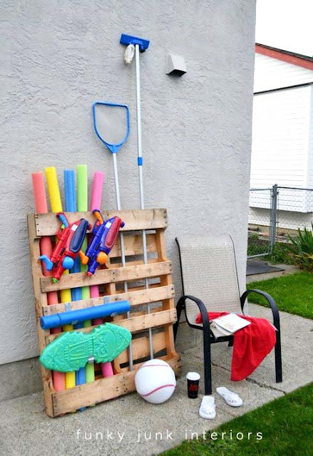 Repurposed shipping pallet pool toy storage. Awesome.