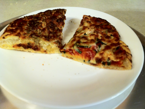 Awesome homemade pizza and cheese bread, not so awesome photography.