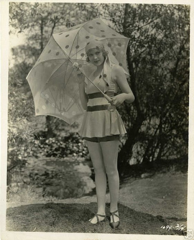 modcloth:  A matching parasol and headscarf, of course. Photo via vintage everyday.