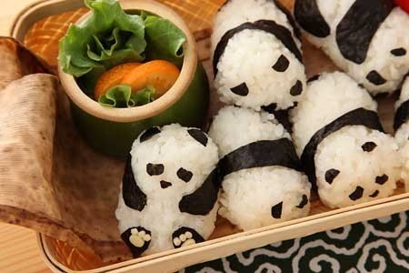 "[Foodstuffs] What is better than onigiri, these famous Japanese rice balls? Panda-shaped onigiri of course! Japanese rice balls are typically made out of white rice wrapped in dried seaweed. The fillings are usually salty or slightly sour, but anything from ""pickled ume"" to salty salmon/cod will do. If you live in or near Japan, these are probably your best friend in bento boxes for take-out or lunch at school. I have to admit, even though I don't like seafood, these are way too adorable! - Jenny"