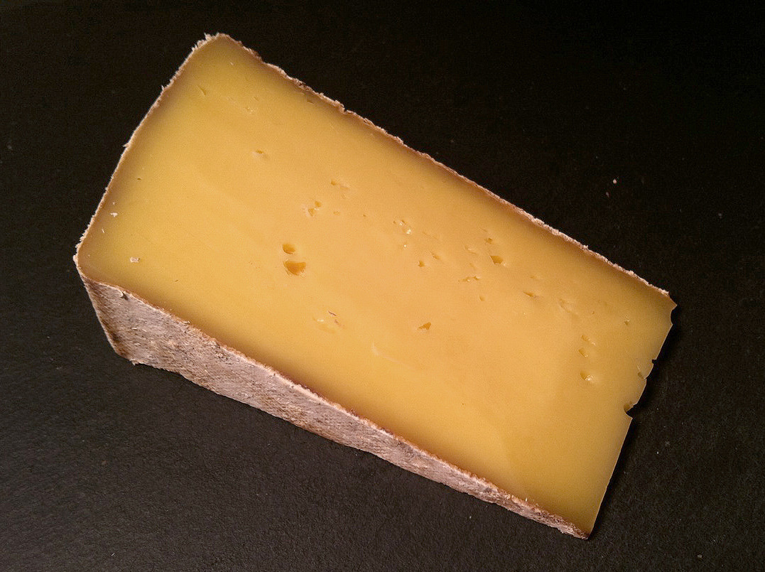 Appalachian, from Meadow Creek Dairy in Virginia. Meadow Creek is one of the cheese makers that has really put the South on the cheese map (along with Sweetgrass Dairy and others). Best known for Grayson, a pungent washed-rind delight, they also make this wonderful semi-soft cow's milk Tomme. Appalachian is buttery and smooth in the mouth with a bright, mild, lightly tangy flavor with hints of mushrooms, citrus and nuts.  This is an excellent melter for grilled cheeses.   Purchased at Stinky Brooklyn.