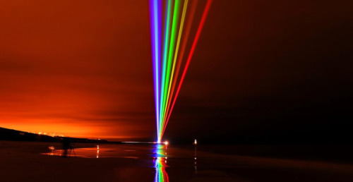 Global rainbow light installation. via Colossal.