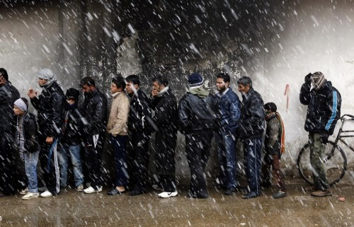 inothernews:  THE WAIT   Men stood in line to buy bread at a bakery in al-Qusayr, Syria, Thursday. In  Baba Amr, Homs, rebels staged a 'tactical retreat' to spare civilians  from attacks by government forces. (Photo: Goran Tomasevic / Reuters via the Wall Street Journal)