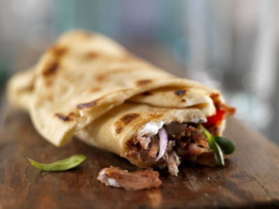 pork belly gyro with raita and grilled vegetables