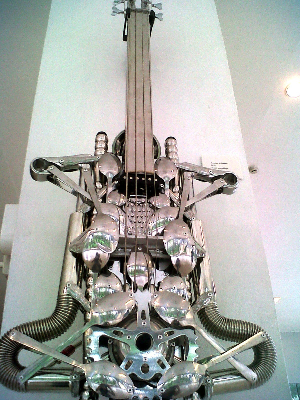 artshots:  Stainless Metal Bass Guitar Sculpture by Lirio Salvador.