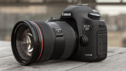 vimeo:  photojojo:  IT'S HERE. Or just about here. Welcome Canon's newest DSLR: the Canon 5D MarkIII. It's 17x faster than the MarkII thanks to a new processor.  It has a shiny full-frame sensor that snaps more megapixels, 22.3 of them. It can now shoot at 60fps which makes for awesome slow-mo video. It's $3500, but we don't really need this spleen anyway. Canon's New 5D MarkIII DSLR: Faster & More Pixely photo by Mario Aguilar; via Gizmodo  Um, you guys. YOU GUYS. IT'S HERE!!