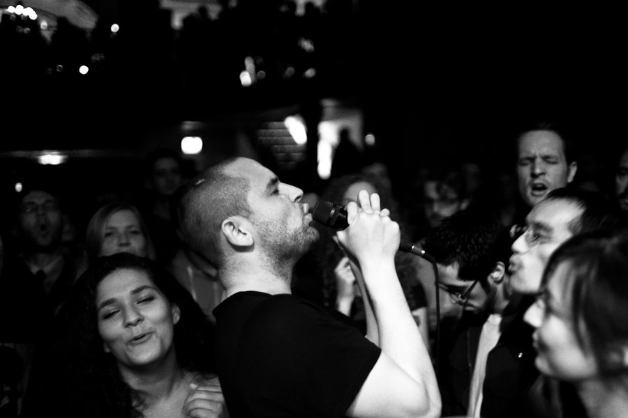 "James Graham of The Twilight Sad surrounded by the crowd as they help him sing ""Cold Days From The Birdhouse"" at the Bowery Ballroom in October of 2009. © Dominick Mastrangelo"