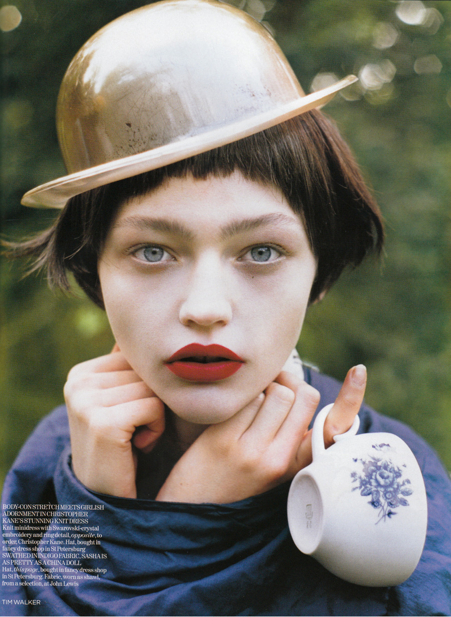 """White Nights""; Sasha Pivovarova by Tim Walker for British Vogue  The serene blank look and elfin grace were put on hold for her most sustained moment with British Vogue - Tim Walker's 27-page epic 'White Nights', as meticulously planned as Napoleon's assault on Moscow but with more attention to detail. (Sasha revealed that she has read War and Peace at least twice, which is pre-production enough.) Walker suggested a two-week trip covering thousands of miles. (Red lights flashed and budgetary constraints kicked in at this point.) In the end, in the glowing white light of the midnight sun, on the Russian Island of Eglovo in Lake Onega, Sasha was required, among other novelties, to sport 'swan's head' shoes and balance teacups on her head, as well as a gold plastic bowler hat. In so doing she revealed a playful side, unexpected from the Prada ice-maiden. Also unforseen were the ministrations of the local priest. Glancing at Sasha, who was wearing a pleated lamé jacket in the evening light, he said approvingly: ""I am not sure what you are doing but I like it."" However, the light-hearted trip was not without it's moment of Chekhovian sorrow: two sisters sang old Russian folk songs, narratives telling of the death of traditional rural life. Moved greatly, Sasha wept.   - The Faces of Fashion, Vogue Model"