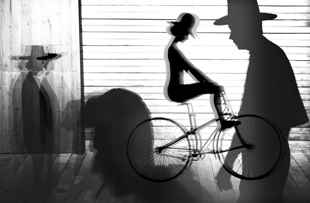 firsttimeuser:  Kate Cycles to the Saloon by Sam Haskins