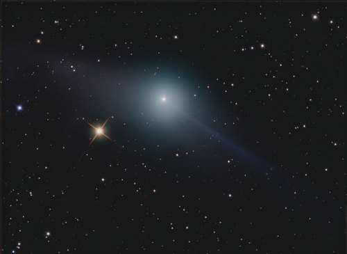 (via APOD: 2012 February 28 - The Opposing Tails of Comet Garradd) Comet Garradd, poised to make its closest approach to Earth, shows off its two tails in opposition, dust tail trailing, looking yellowish with random light scattering, and ion tail pushed ahead by the solar wind, looking blue with chromatic light scattering in blue thanks to carbon monoxide ions. Image Credit & Copyright: Robert Pölzl