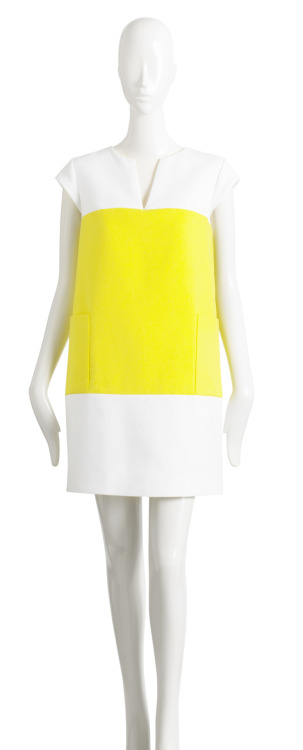 This spring, it's all about the color-blocking trend.  Brighten up your look with a luminous hue by simply choosing geometric, bright shapes in your wardrobe.  This cotton dress from the summer 2012 collection of Kate Spade New York shows you how to rock the fun trend with a simple one piece.  For more fashion fun, just click the photo. CottonCandyMag.com