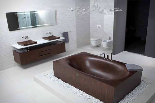 Thanks to the ergonomic design of the Laguna range of bathtubs,  one can enjoy a relaxing bath alone or in company. The highly resistant  special varnish has been tested under the hardest conditions. It  guarantees optimal protection and ensures that the wooden bathtub will  have a very long service life. As a result of the modular form of  construction, our wooden bathtubs can be supplied in different forms of  execution. Thus, they can be supplied as fully equipped Jacuzzis and can  – if the customer so desires – be installed direct in a bathroom or  yacht. The use of wood as natural material in combination with our  know-how from modern yacht building makes it possible for us to produce  for you your personalized bathtub.