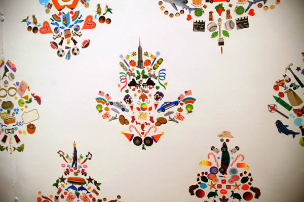 anthropologie:  Upon closer inspection of Flat Vernacular's playful wallpaper, one realizes that it is in fact an exceptionally precise design of stickers. Each pattern consists of thousands of hand-applied stickers, which can be taken off and repositioned at any time. Via: Flat Vernacular