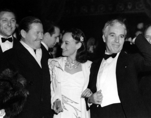 "Charlie Chaplin, Paulette Goddard and Jack Oakie at premiereof ""The Great Dictator"". Capitol Theatre, New York, 15 October 1940"