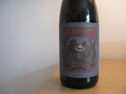"Beer: Robert Johnson's Hellhound On My AleBrewery: Dogfish HeadLocation: Milton, DEType: American Double/Imperial IPAIn Three Words: hoppy, lemony, bold Once again, Dogfish Head manages to take a beer trend I think I am tired of and make it delicious. We all know hops are a thing right now and the hoppier the beer, the more you are supposed to enjoy it, right? Not always. Some beers severely overdo it and make it difficult to enjoy the drink at all. But this beer, the Hellhound Ale, is absolutely delicious. Besides the hops, there is a huge amount of citrus flavor that comes through upon the very first drink. Till the last drop in the bottle, the taste is bold and delicious. On the bottle they have inscribed at the bottom ""Ale brewed with lemons"", which is what first intrigued me; that lemon taste is definitely my favorite aspect of the beer. Absolutely delicious. To balance out the hops there is a tad bit of sweetness that comes through and a heavy carbonation. I honestly felt like I was drinking a citrus fruit drink at times were it not for the perfect amount of alcohol taste that surfaces at the end of each sip. Surprisingly, despite the amount of hops and citrus fruit involved in the making of this beer, it is not that bitter. Maybe this is what places this beer over the other ones in the hop fad that is going on. Dogfish Head certainly knows how to brew 'em. Thank god this only comes in large bottles; you're not going to want any less. In addition to this, fun tidbit about the name of the beer, straight from the Dogfish Head website: ""2011 would have marked the 100th birthday of Mississippi Delta bluesman Robert Johnson, who according to legend, sold his soul down at the crossroads in a midnight bargain and changed music forever. Working again with our friends at Sony Legacy (yup, the same folks we did our Miles Davis-inspired Bitches Brew with), Dogfish Head paid tribute to this blues legend by gettin' the hellhounds off his trail and into this finely-crafted ale."""