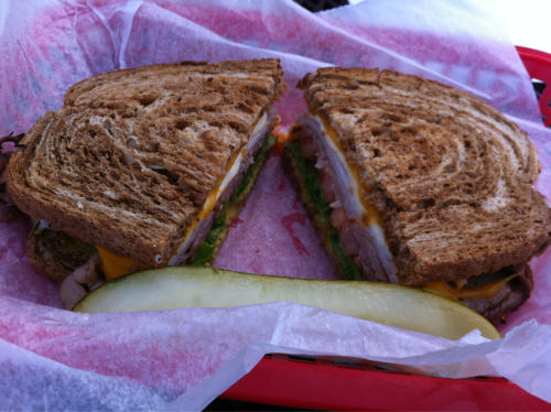 The Politically Incorrect from Young Ave. Deli: ham, roast beef & turkey with cheddar, pepperjack, spicy mustard, lettuce & tomato on marbled rye.