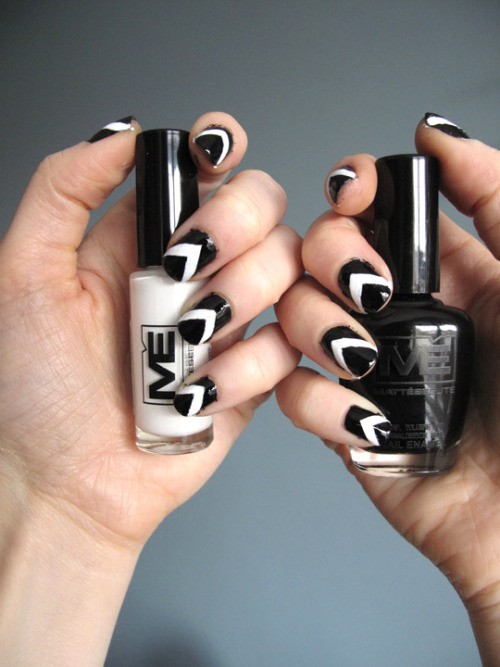 annamarie:   Fancy Nails!! Matesse Elite Nail Polish - Black Matesse Elite Nail Art Paint - White OPI - RapiDry TopCoat Here's how to do chevron nails.  1. Apply two coats of black polish and allow to dry completely 2. Using scotch tape make guides on your nails for the white polish.  Use the straight edge of the of the tape and apply diagonally to create the open V shape. 3. Paint the open V white and allow to dry completely. 4. Remove the tape very carefully 5. Paint with a top coat