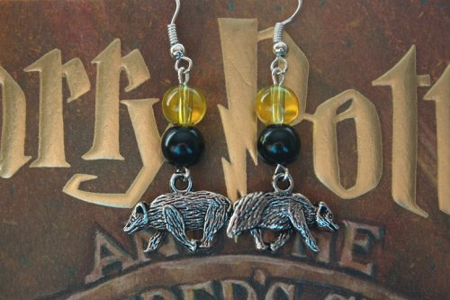 xoxobigfoot:  Hufflepuffs, show your house pride! Hufflepuff earrings are available on eBay now for just $3.99! http://www.ebay.com/itm/170792044894