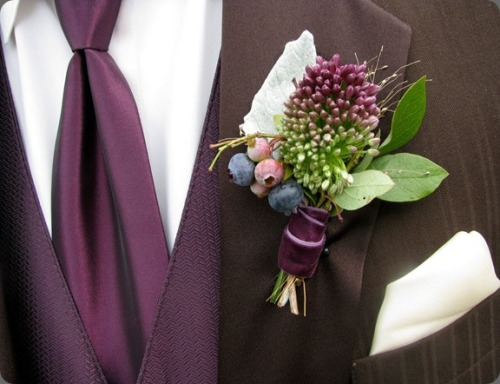 drumstick allium and blueberry boutonniere tied with purple velvet ribbon