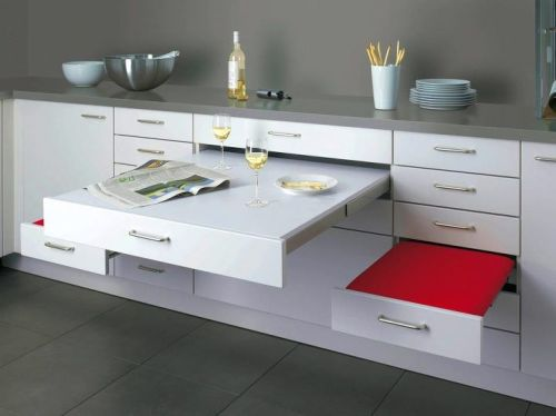 Space saving pull out dining for two from Alno