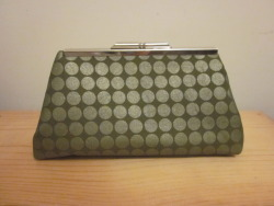 """Seeing Spots"" clutch in army green."