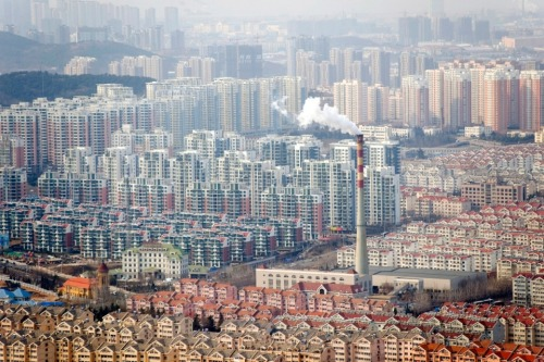 Photo of the Day: Qingda, China Residential buildings cover the landscape of downtown Qingdao in China's Shandong province.  China's four biggest state-owned banks said they will continue implementing the differentiated housing loan policy as the housing prices in China continue to decline. (Wu Hong, EPA / Landov)  What video game does it remind you of?