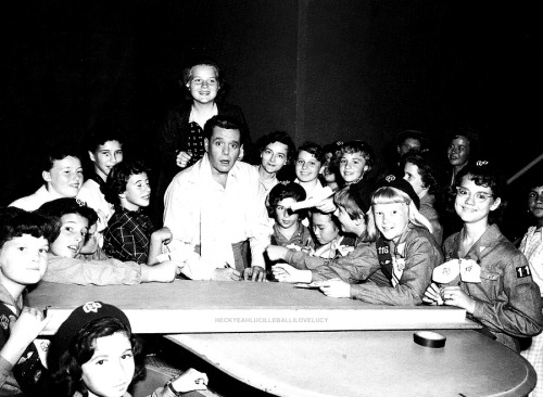 Desi Arnaz with a group of fans
