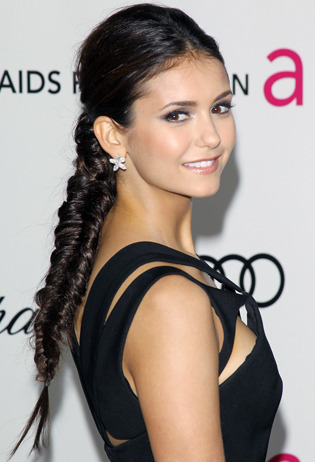 Celeb hairstylist Riawna Capri tells us how to achieve Nina Dobrev's chic fishtail braid spotted at Elton John's annual Academy Awards party. Learn how to recreate the look here »