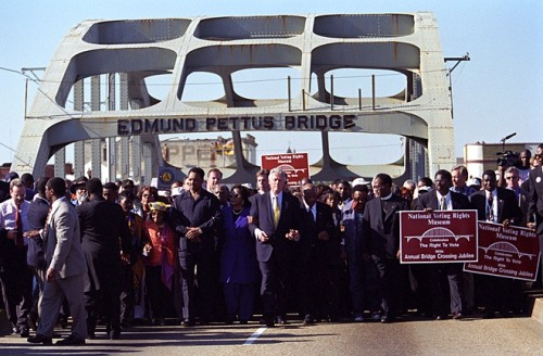 35th Anniversary of the 1965 Voting Rights March in Selma President Bill Clinton, Reverend Jesse Jackson, Coretta Scott King, and Representative John Lewis join hands and they lead the march across the Edmund Pettus Bridge to commemorate the 1965 March.  March 5, 2000.