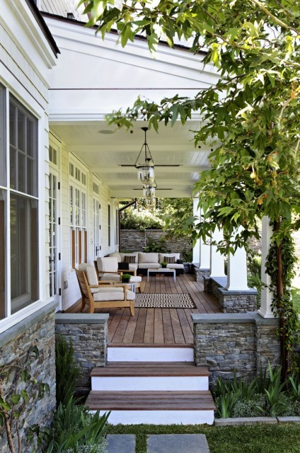 Charming front porch practically invites you to sit and relax a while (via Tim Barber LTD Architecture & Interior Design)