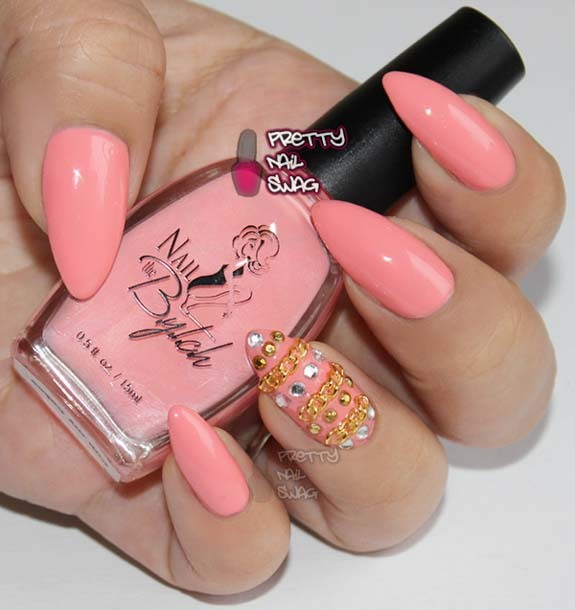 prettynailswag:  Nail the B.Y.T.C.H. - Cup My Cakes I came across this DOPE nail polish brand through Twitter and as soon as I saw the name, I had to cop a few bottles.  Nail the B.Y.T.C.H. is an acronym for Be Your True Creative Heroine.  (such a sick name for any nail artist!!)  I've been looking for the perfect pinky-peach-coral polish to rock this summer with a fresh tan and this is it, absolutely loving this colour.  Application was smooth and very opaque after only 2 coats, I used 3 coats here and added some chains & bling.  Click the pic to check them out, they have 10 colours right now and they're only $6 each.