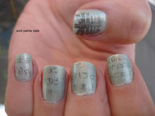 andipaintsnails:Close-up of my moms newsprint nails. I love how it came out a little faded and worn looking :)