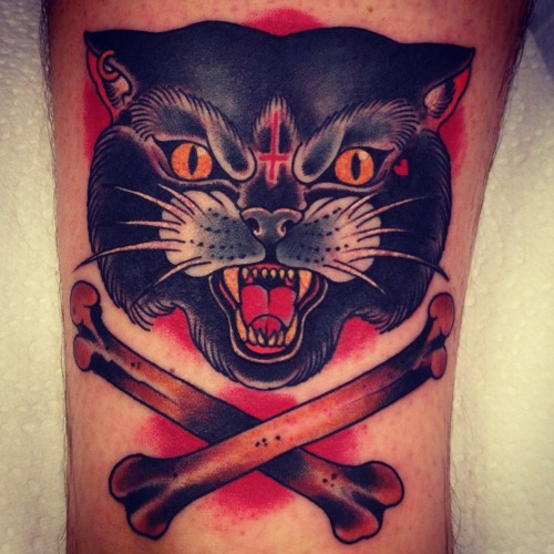 dermagraphique:  tattoosforpassionnotfashion:  done by xam  I love this cattoo! These bones are fucking perfect. Xam really pulled off the subtleties in making something look like a black cat instead of a panther. All the little details in this are just too cool.