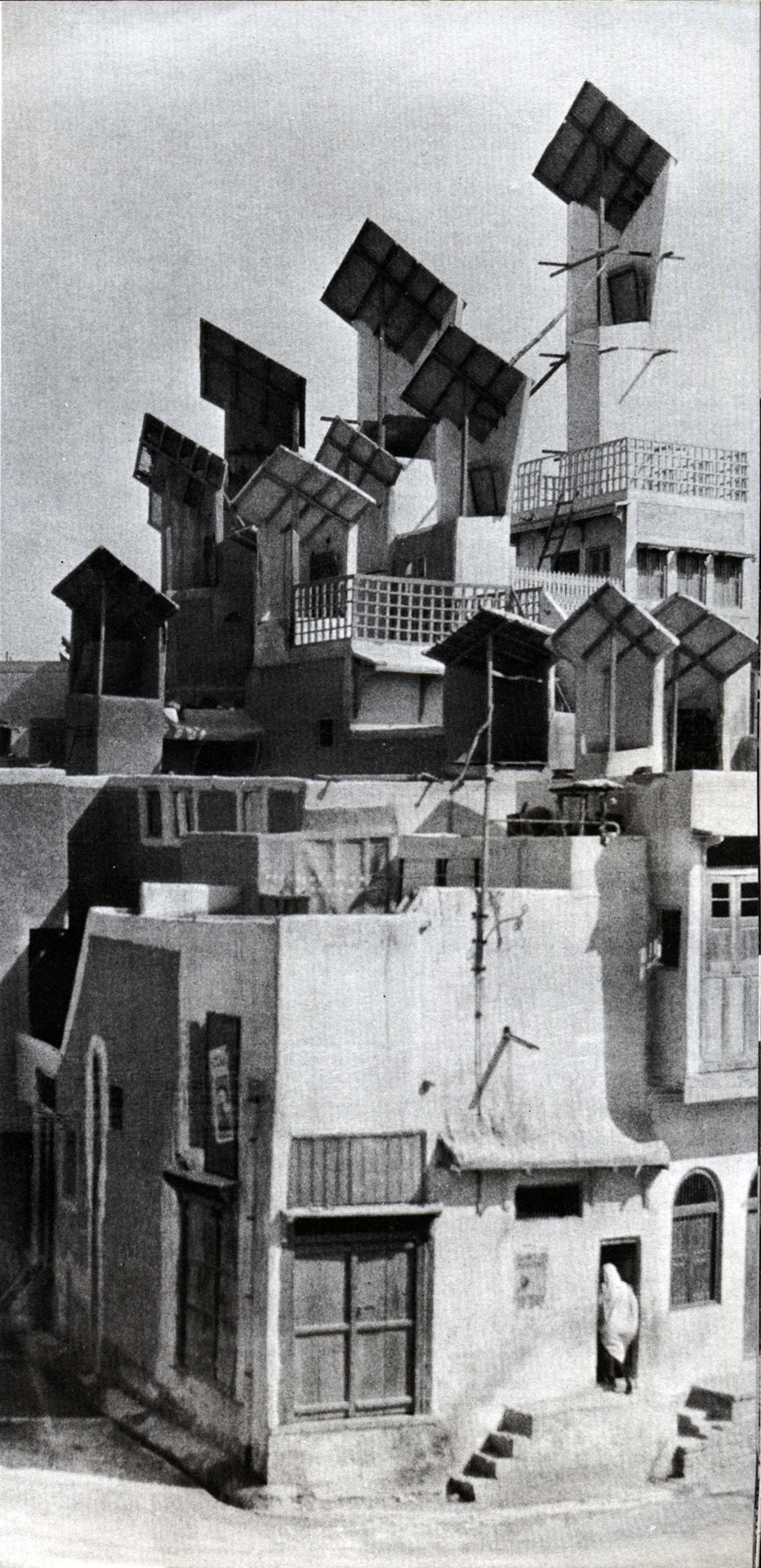"icancauseaconstellation:  The Wind Catchers of Hyderabad 1928 - Photo from the book ""Architecture without Architects"" by Bernard Rudofsky. The city of Hyderabad in the Sindh province of Pakistan was once dominated by a roofscape of towering wind catchers, or ""bad-gir"", as they were known locally.  These fixed wind scoops would provide ventilation to the whole household in the hot summer days. The heating of the chimney would cause cool air to be drawn from high up and would then be channeled through the rooms and out the front door. This method had been in use in the city for over five hundred years, but has now mostly been replaced by mechanical air conditioning with the chimneys being used to install satellite dishes."
