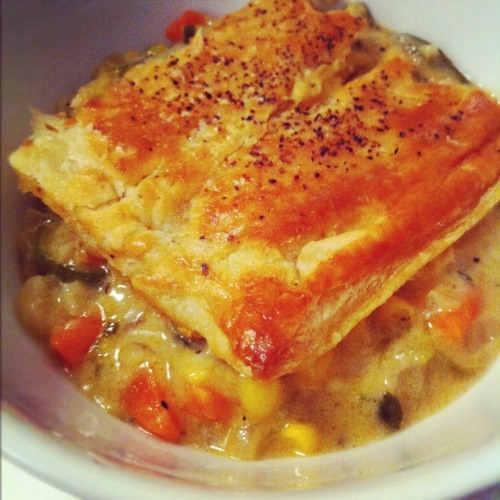 HomeCookin': Vegetable Pot Pie w/ fennel, carrot, leek, zucchini and corn.  Pre-heat oven to 400F. Thaw out a sheet of pre packaged Puff pastry. Or… g'head… make your own. ;)  In a large pot, saute 2 cloves garlic, 1 cup diced onion, 1 cup chopped leeks, 1 cup chopped fennel, 1 zuchinni, 1 cup button mushrooms, 1 large carrot and 1 cup of fresh/ or frozen corn until tender. About 10 mins… Stir through 2tbsp flour and cook through for 1 min.  Pour in 3/4 cup of stock and 3/4 cup of milk and bring to the boil. Stir through 2 tbsp dijon mustard.  Simmer until sauce thickens. Stir through a 1/2 cup chopped cilantro. Add salt and pepper to taste and a 1/4 cup of cheese.   Pour vegetables into a pie dish and cover with puff pastry. Poke a bunch of holes for ventilation, and brush with egg. Sprinkle with salt & pepper.  Bake in the oven until pastry rises and browns. About 25-30 mins.  Let the pot pie stand for 10 mins before serving with a crisp salad.