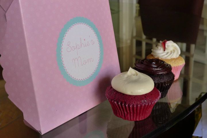 "Sophie's Mom Cupcakes (and other sweet treats) ""If Sophie's Mom was my mom, I'd be really fat"", said Nica after we paid a visit to their quaint and fresh-baked-smelling shop in San Antonio Village.  With their cupcakes, mochi ice cream, and all their delicious bread and cookies, I have no doubt that I would be too. It was a last-minute decision to have Sophie's Mom cupcakes as snacks during our Punchdrunk Panda Skimmer Webisode shoots with JP Cuison, Saab Magalona, Ge Mapa, Selena Salang, Robbie Bautista, Cheyser Pedragosa, Kitkat Pecson, Patricia Prieto, Kasey Albano & Arriane Serafico. I had been thinking earlier in the week of our shoot about what food I was going to provide as snacks, and then I had a eureka moment and remembered Sophie's Mom. We usually see them at bazaars we participate in as well, and when we do see them around, we're sure to get their Mochi Ice Cream (P40). :) I've tried their Frozen Brazo, Strawberries & Cream, Cookie Dough & Lemon Meringue, and the Lemon Meringue is my personal favorite. Though I've yet to try their Banoffee & Red Velvet Mochi Ice Cream. :) So anyway, I immediately contacted Tita Tonette Rosal to ask if she would be able to provide me cupcakes for our shoot on the following day, and luckily, she was able to pull through for us! :) Punchdrunk Panda loves Sophie's Mom! :D  In the three days that we were shooting webisodes, I personally got to sample their: Day 1: Spanish Bread (P12), which has this unique pastillas-like-filling — better than your average Spanish bread. Day 1: Red Velvet Cupcake (P50), which has rich cream cheese frosting, while the cupcake itself has chocolate bits mixed into the batter @_@ — it's REALLY good, though I tend to get overwhelmed by super cream cheesy things in general, but even so, I found this really yummy. Day 2: I bought myself a Red Velvet Cookie (P50) and the Cheese Raisin Loaf (P80) — the Red Velvet Cookie is interesting as it is quite literally a Red Velvet Cupcake in cookie form. So yeah, thumbs up for this too! — I must say I was a little disappointed with the ""Cheese"" Raisin Loaf though, because it looked so cheesy, and being a super cheese girl and an anti-raisins-except-when-eaten-alone girl, I was looking for more cheese and less raisin. But otherwise, it's an excellent option for raisin and cinnamon lovers. Day 2: Ensaymada (P35), cheesy and super chewy-soft bread — I just had a bite from Nica's because I'm not a super ensaymada girl, but it was REALLY good (sorry, people, I do not have other adjectives). I mean, being a non-ensaymada girl, this is actually an ensaymada I would go out and buy. So that says a lot. Day 3: Hazelnut Praline Sweet Buns (P10), Nutella-filled buns — enough said. Haha! Day 3: Toffee Caramel Buns (P20), caramel-filled rolls — the bread was uh-mazing. The filling was a bit sweet for my taste, but I would buy this for the bread. YUM. Day 3: As if I did not have enough Sophie's Mom during the week, I bought a Red Velvet Cupcake, Tres Leches w/ Strawberries Cupcake (P50), and a Dulce de Leche Cupcake (P50), all for myself — Tres Leches is a light cake soaked and filled with 3 kinds of milk, rum and fresh strawberries or mangoes, while the dulce de leche is a chocolate cupcake with filling and ganache frosting — and oh my god, I practically finished all 3 in one sitting. I must have gained 3 pounds this week.  I usually have Red Velvet cupcakes on the top of my favorite pastries/cupcakes, but I have to say, that the Tres Leches is also a strong contender. I wanted the one with mangoes though, but the one with strawberries was really good too! Like a Strawberry Short Cupcake. Since I tend to favor lighter, less rich desserts/sweets, this one sat with me very well. :) * I can't really be a food blogger or anything because I usually dig into whatever is presented in front of me before taking a photo, but I managed to gather enough EQ to take the below shot.  So my top 3 picks among the new treats I tried would be: Tres Leches Cupcake Ensaymada Red Velvet Cookie But yeah, Sophie's Mom staples would be their Mochi Ice Cream & Red Velvet Cupcakes. :) Their store is located at 8760 Santol Street, San Antonio Village, Makati, BUT their aiming to open their little take-out kiosk in SM Megamall Bldg. A (in front of National Bookstore) by March 16, 2012. (OMG SO MUCH CLOSER TO HOME)We're also hoping to get them to join Anteroom Sessions 2 on March 31, 4-11pm at Cubao X. :D So yeah, 'til you get the chance to visit their store or catch them at a bazaar, you can drool at all their yummy goodies here. Tres leches pounds heavier but happy,Jen"